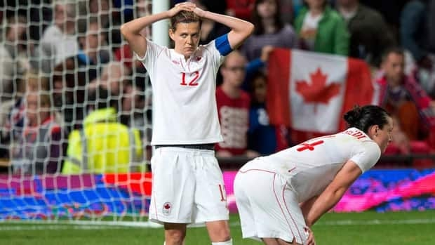 FIFA suspended Canadian women's soccer captain Christine Sinclair (12) four games on Friday for unsporting behaviour toward officials during a game against the United States at the London Olympics.