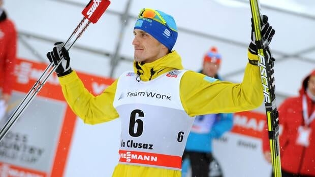 Kazakhstan's Alexey Poltoranin won the men's 15-kilometre classical-style mass start race in a sprint finish, clocking 37 minutes, 11.6 seconds to beat Russia's Alexander Bessmertnykh by .01 seconds.