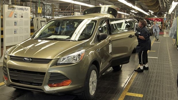 A 2013 Ford Escape is assembled in the company's Louisville, Ky. assembly plant. The company is recalling some versions of the vehicles due to possible engine fires.