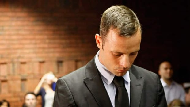 Oscar Pistorius, who faces a murder trial next month in the killing of his girlfriend Reeva Steenkamp, says he is consumed by sorrow on the first anniversary of her death.