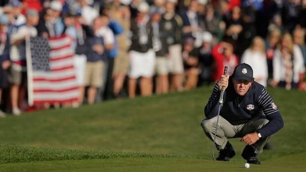 Phil Mickelson lines up a putt on the sixth hole during a foursomes match at the Ryder Cup PGA golf tournament on Saturday at the Medinah Country Club in Medinah, Ill.