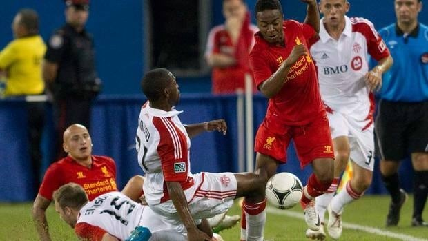 Liverpool's Raheem Sterling, centre left, skips past Toronto FC's Ashtone Morgan, centre during second half action of their friendly match at the Rogers Centre on Saturday.