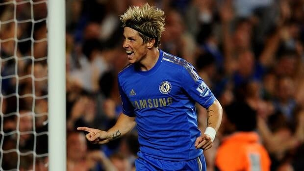 Fernando Torres of Chelsea celebrates scoring their third goal during the match against Reading at Stamford Bridge on August 22, 2012 in London.