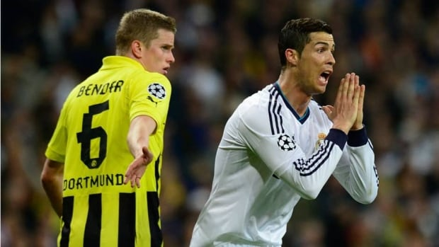 Real Madrid's Cristiano Ronaldo, right, reacts next to Dortmund's midfielder Sven Bender during their UEFA Champions League semi-final second leg football match in Madrid on Tuesday.