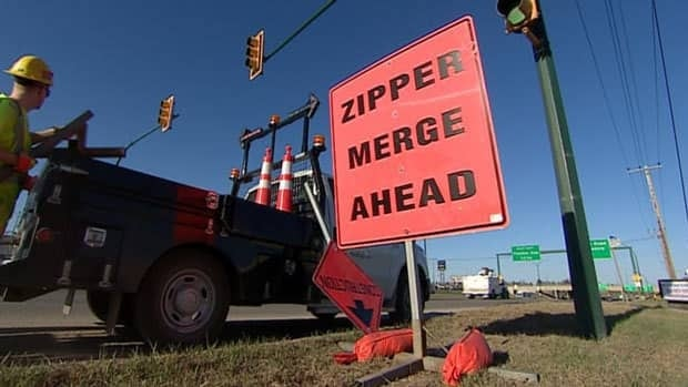 The City of Saskatoon is experimenting with new signage that tells drivers to use both lanes up until the merge point.