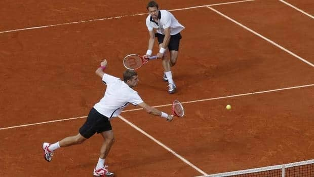 Max Mirnyi of Belarus, left, and Daniel Nestor of Canada, right, return in the men's doubles final match against Bob and Mike Bryan of the U.S. at the French Open on Saturday afternoon. Nestor and Mirnyi won the championships.
