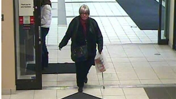 Police said the woman may be wearing a false tooth and a wig, and carries a cane.