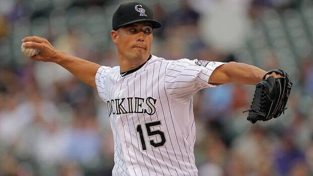 Starting pitcher Jeremy Guthrie of the Colorado Rockies delivers against the Oakland Athletics.