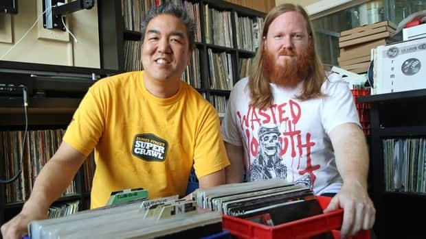 Mark Furukawa, left, and Andy Inglis sit among crates of records inside Dr. Disc, Furukawa's downtown music store. Both men are involved in organizing Discography, a vinyl-only DJ night that debuted on Sunday.