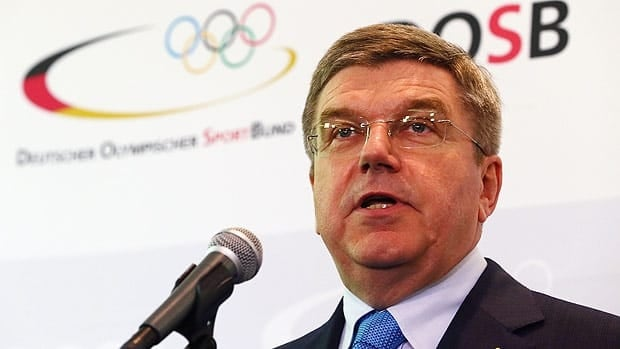 Thomas Bach, International Olympic Committee vice president is seen making his announcement Thursday in Munich.