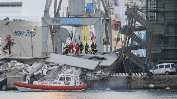 The collapsed control tower is pictured at Genoa's port harbour on Wednesday. At least four people were killed and six injured when a container ship rammed a control tower in the northern Italian port city late on Tuesday.