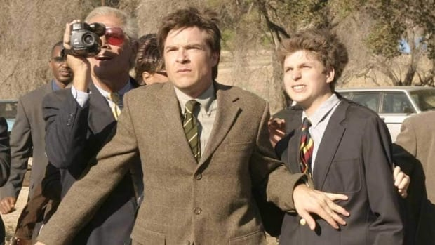 Jason Bateman, centre, and Michael Cera, right, are shown in a scene from the Fox TV series Arrested Development which resumes this May on Netflix after a seven-year hiatus.