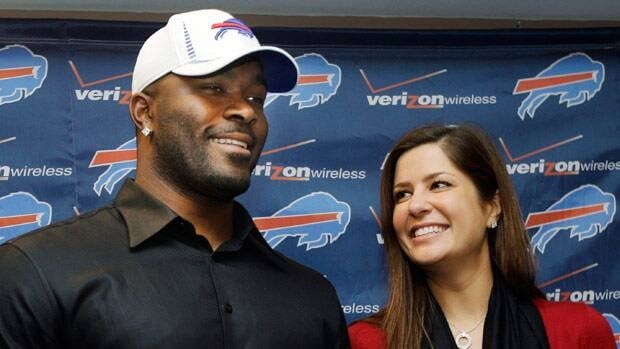 Mario Williams poses is seen with ex-fiancee Erin Marzouki in happier times, when he signed a lucrative contract with the Buffalo Bills in March 2012.