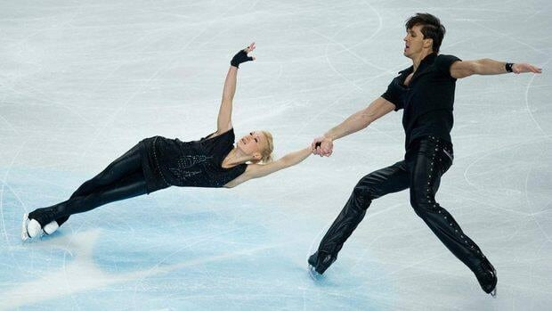 Tatiana Volosozhar, left, and Maxim Kamianchuk perform their short program Wednesday in England.