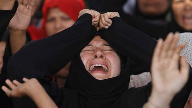 A Pakistani woman mourns the deaths of those killed in a bombing on Saturday in Quetta, at a rally to condemn violence against Shias.