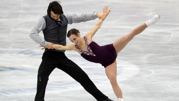 Meagan Duhamel and Eric Radford of Canada skate after the medals ceremony for the pairs competition during day three of the ISU Four Continents Figure Skating Championships at Osaka Sunday in Osaka, Japan.