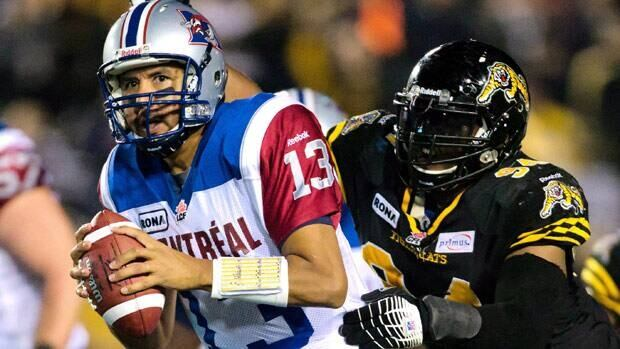 Montreal Alouettes Anthony Calvillo is sacked by Hamilton Tiger-Cats Jermaine McElveen during the second half of a September 2012 game.