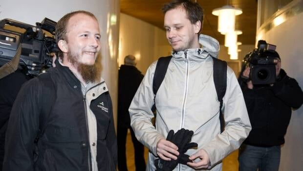 Pirate Bay founders Gottfrid Svartholm Warg, left, and Peter Sunde arrive at the Stockholm district court on Feb. 16, 2009. Four of the file-sharing website's founders were convicted of assisting copyright infringement by helping millions of the site's users to illegally download music, movies and computer games. Svartholm Warg was arrested in Cambodia last Thursday and could be extradited to Sweden, where he faces a one-year prison sentence.