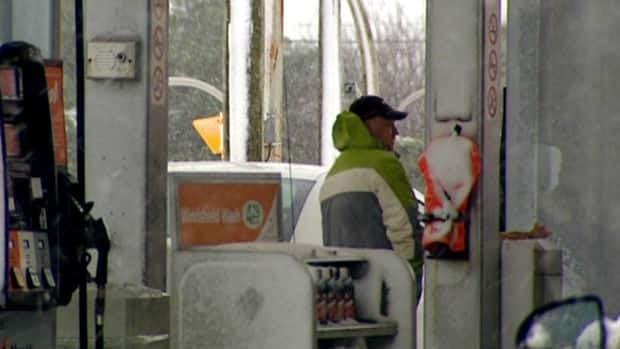 A driver fills up his tank at a gas pump in St. John's in this file image.