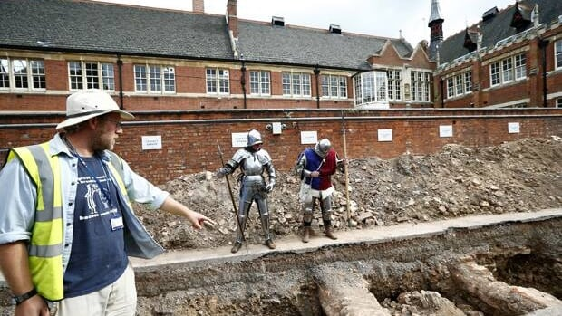 Archeologist Mathew Morris points to where he found a skeleton thought to possibly be that of King Richard III. The excavation site is under a parking lot in Leicester, central England, where the church in which Richard III was buried is thought to have been located.