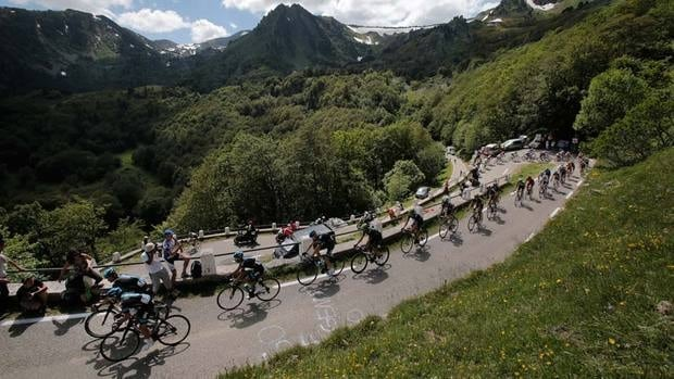 Peter Kennaugh of Britain, Vasili Kiryienka of Belarus, and Richie Porte of Australia lead the Tour de France up the brutal climb of the race's first mountain stage on Saturday.