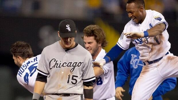 Chicago White Sox second baseman Gordon Beckham (15) walks off the field while Kansas City Royals' Eric Hosmer (35), Mike Moustakas (8) and Jarrod Dyson (1) celebrate during the ninth inning of their 4-3 win on Thursday.