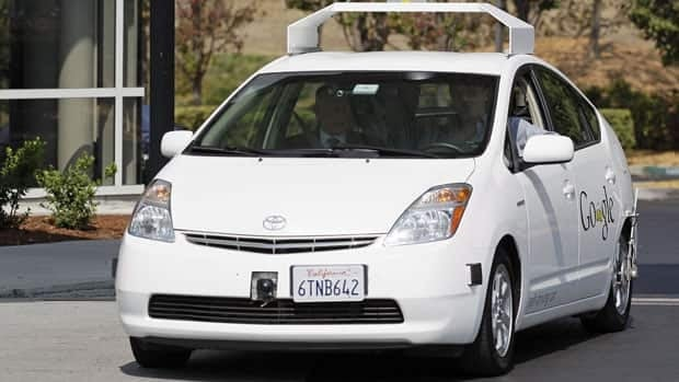 California Gov. Edmund G Brown Jr., front left, rides in a driverless car to a bill signing at Google headquarters in Mountain View, Calif., Sept. 25, 2012.