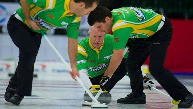 Glenn Howard, centre, delivers a rock en route to winning The National in Dawson Creek, B.C.