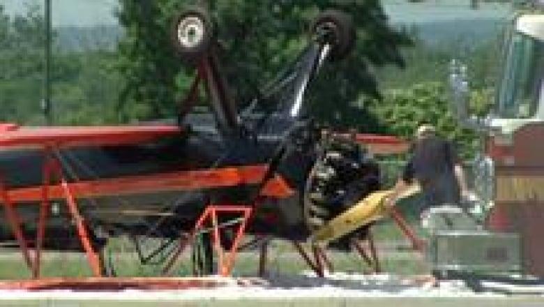 2 injured after biplane flips on landing | CBC News