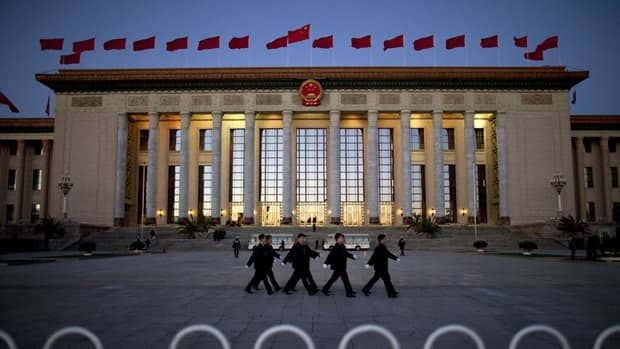 Soldiers dressed as ushers march outside the Great Hall of the People. Xi Jinping, who has been officially named as the next leader of China, will also assume authority over the body that oversees the military, state news agency Xinhua reported.
