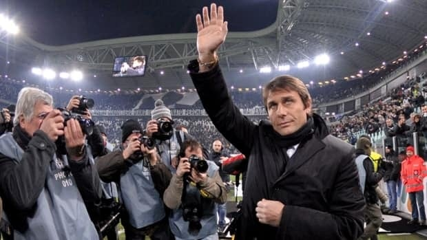 Juventus coach Antonio Conte, right, waves as he arrives for a Coppa Italia (Italian Cup) match between Juventus and Cagliari, in Turin's Juventus stadium on Wednesday, Dec. 12, 2012.