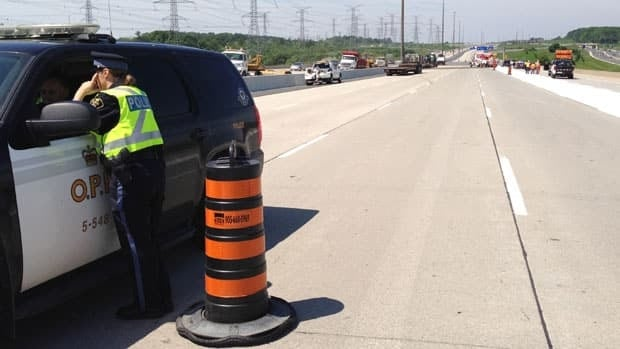 Police closed a section of Highway 407 on Saturday after a dump truck driver died in a single vehicle accident.