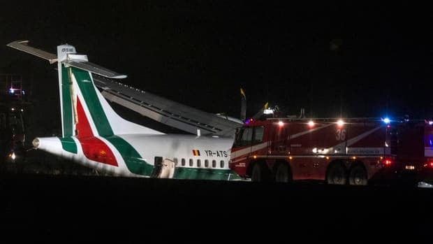 Firefighters are seen next to an ATR 72 airliner of Romanian carrier Carpatair that ended up off the runway upon landing at Rome's International Leonardo Da Vinci airport in Fiumicino, on the outskirts of Rome.