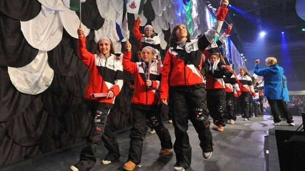 Members of Team Yukon arrive at the opening ceremonies for the 2012 Arctic Winter Games in Whitehorse.