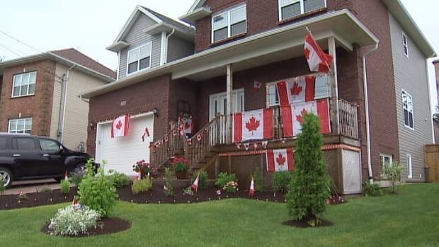 The Perron home is decked in Canada flags.