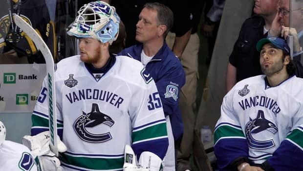Vancouver Canucks goalie Roberto Luongo, right, was replaced for Game 3 against the Los Angeles Kings with Cory Schneider, left.