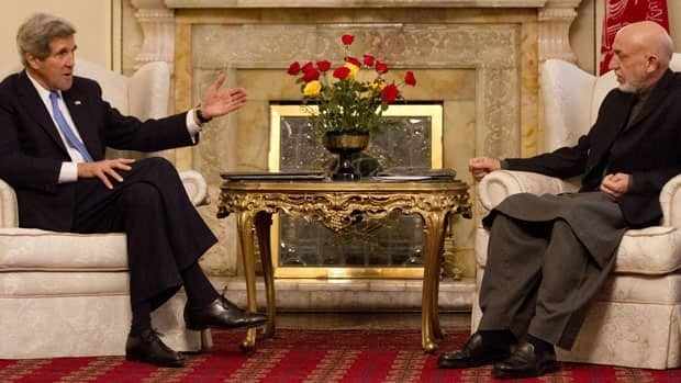 U.S. Secretary of State John Kerry embarked on talks Monday with Afghan President Hamid Karzai. Jason Reed/Associated Press