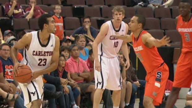 Canadian point guards Philip Scrubb (#23) and Tyler Ennis (#11) face off as Carleton hosts Syracuse Aug. 23, 2013 at the Canadian Tire Centre.