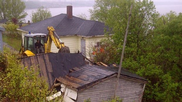A shed near a controversial Corner Brook house is torn down in this June 2012 photograph. Council is now giving the owner month to respond to an order to repair the home or agree to its demolition.