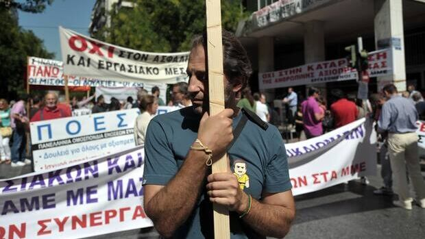 Striking journalists gather outside their union building in central Athens on Monday.
