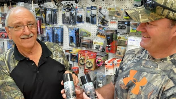 Jimmy Vescio and John Kaplanis check out some some bear attractant spray at a Thunder Bay outdoors store.