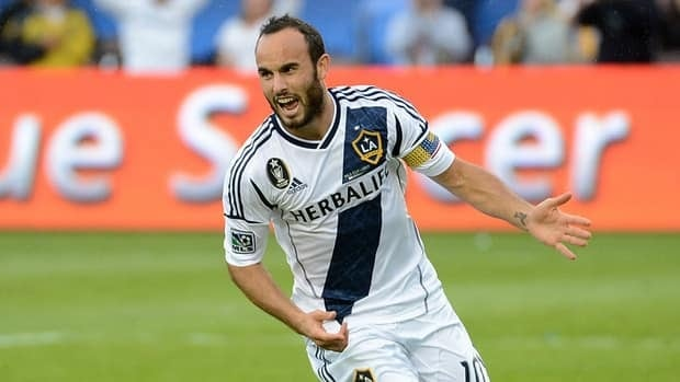 Landon Donovan of Los Angeles Galaxy reacts after scoring a penalty kick against the Houston Dynamo in the 2012 MLS Cup on December 1, 2012.