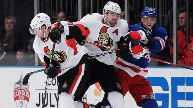 Ottawa Senators defenceman Chris Phillips, centre, will participate in a series of charity games put on by the NHLPA.