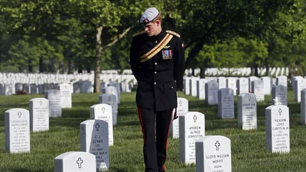 England's Prince Harry visits Section 60 at Arlington National Cemetery, Friday. The British soldier-prince is spending most of his week in the U.S. honoring the wounded and the dead of war.