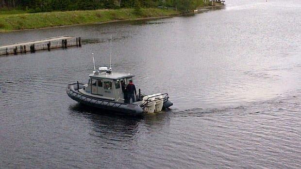 Police search the Mira River in Nova Scotia Saturday.