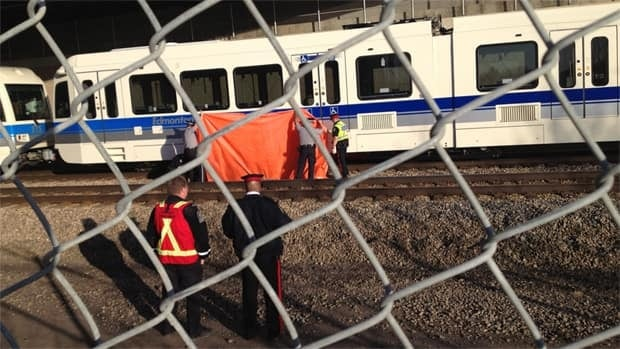 Police at the scene where a body at the LRT tacks between Clareview and Belvedere Monday morning.