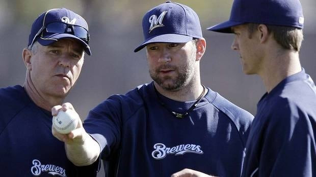 Some believe Brewers' starter Shaun Marcum, middle, was given a cortisone injection earlier this week to calm down the inflammation in his shoulder.