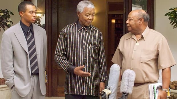 Nelson Mandela, middle, meets Tiger Woods and Earl Woods in Johannesburg on Nov. 30, 1998.