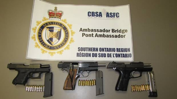Three loaded handguns seized at border.
