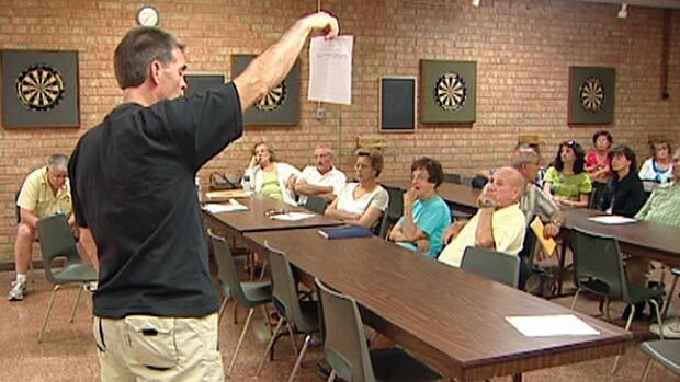 Approximately 35 angry residents who live near the area where the wind turbines are to be erected fired questions at the man who is erecting them.